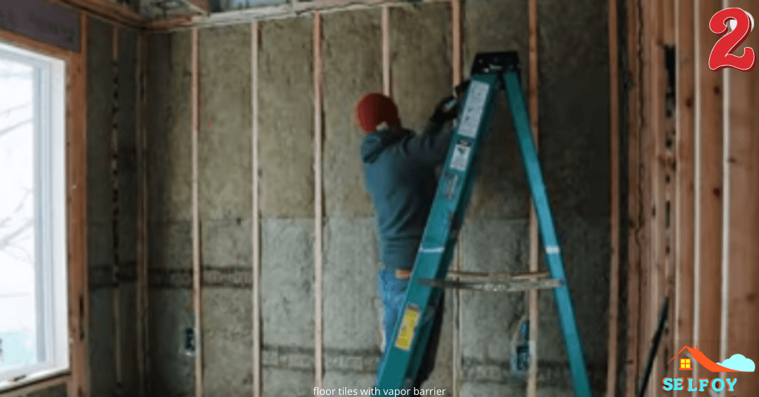 Man started installing vapor barrier over the wall