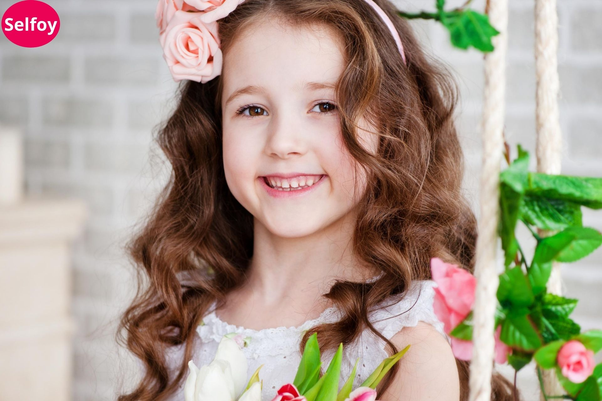 Child wearing pink rose in hairs and smiling and showing Good Personal Hygiene Helps to Develop Positive Self Esteem