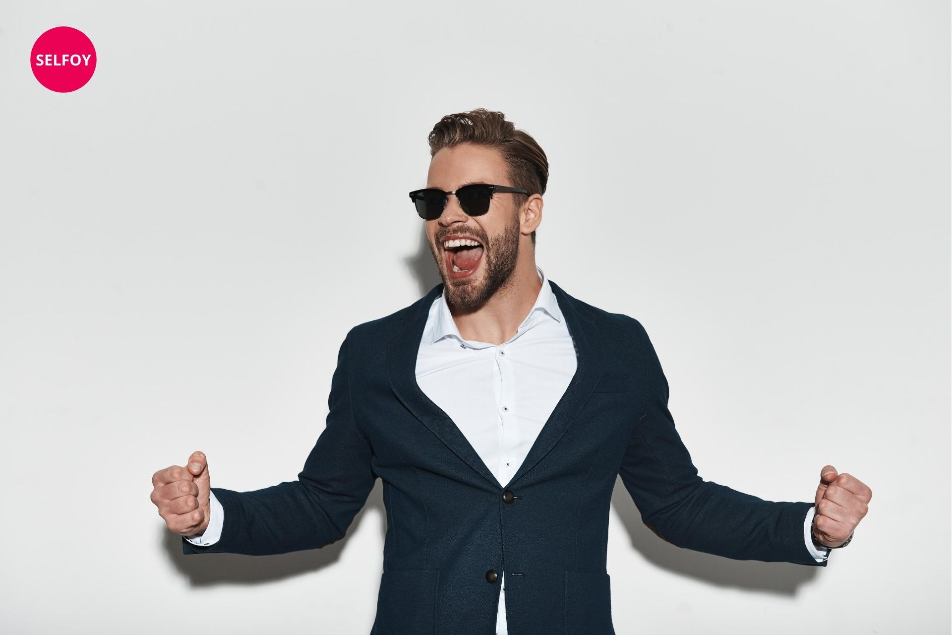 man wearing a black suit and black goggle cheering up
