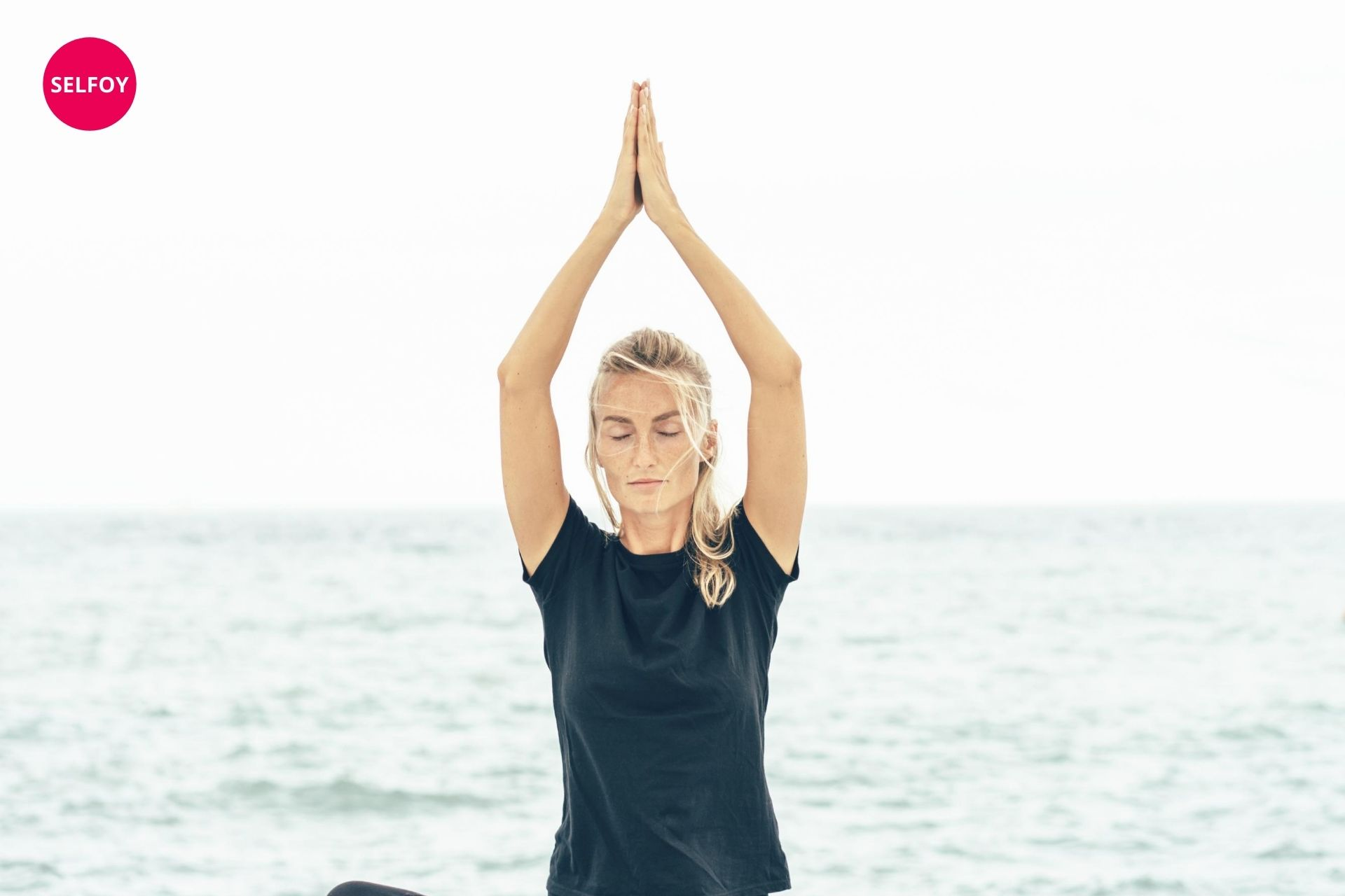 woman in black t shirt doing yoga and thinking about does autodidact work with self care