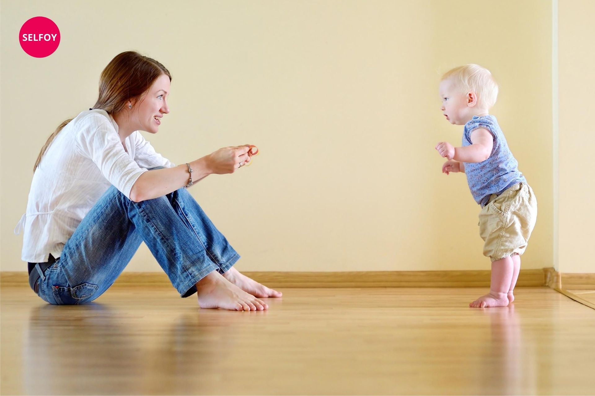 woman playing with her baby and collecting life experiences which are nothing but self esteem