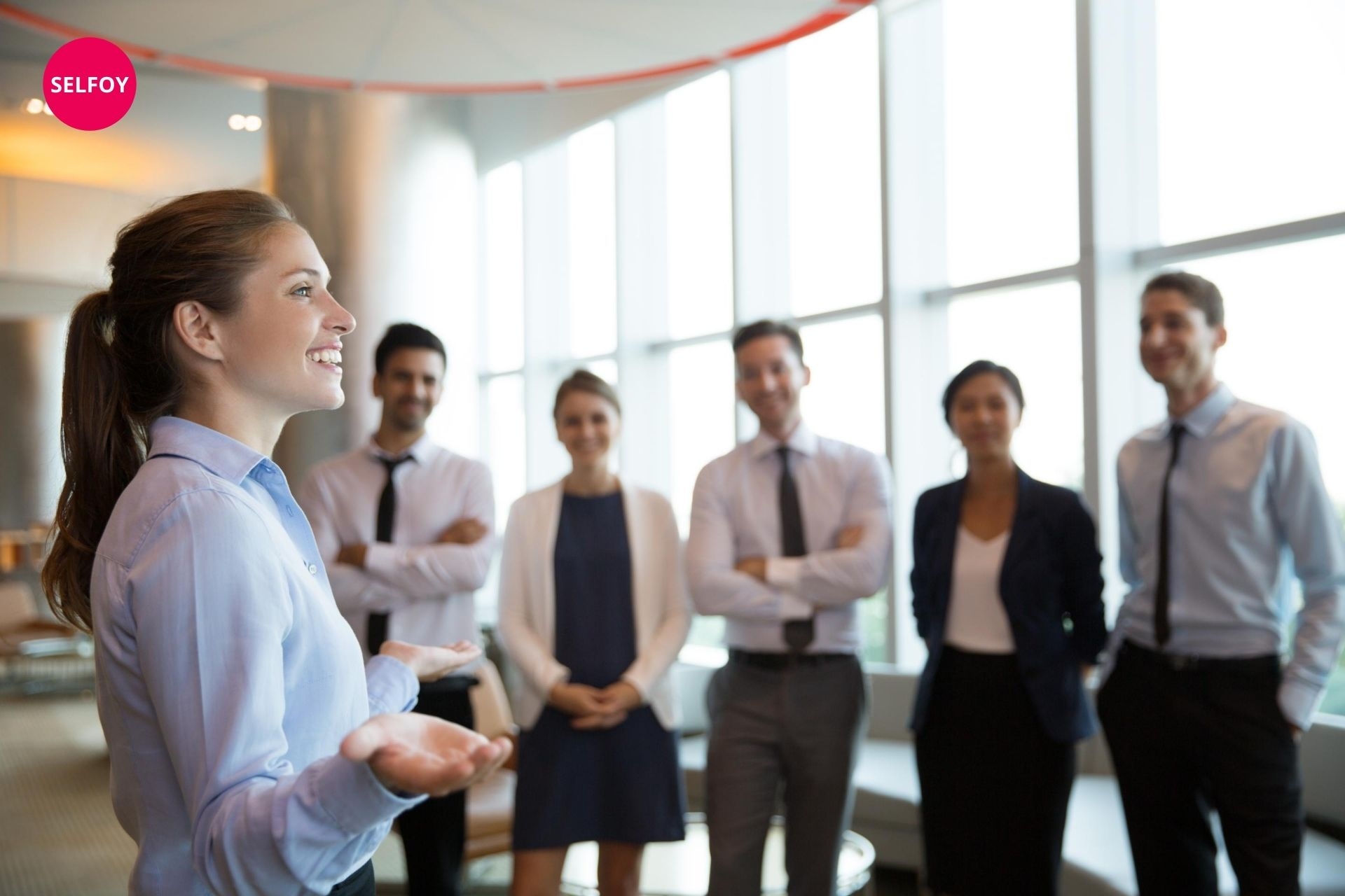 woman smiling and saying does autodidact work with self care to her team
