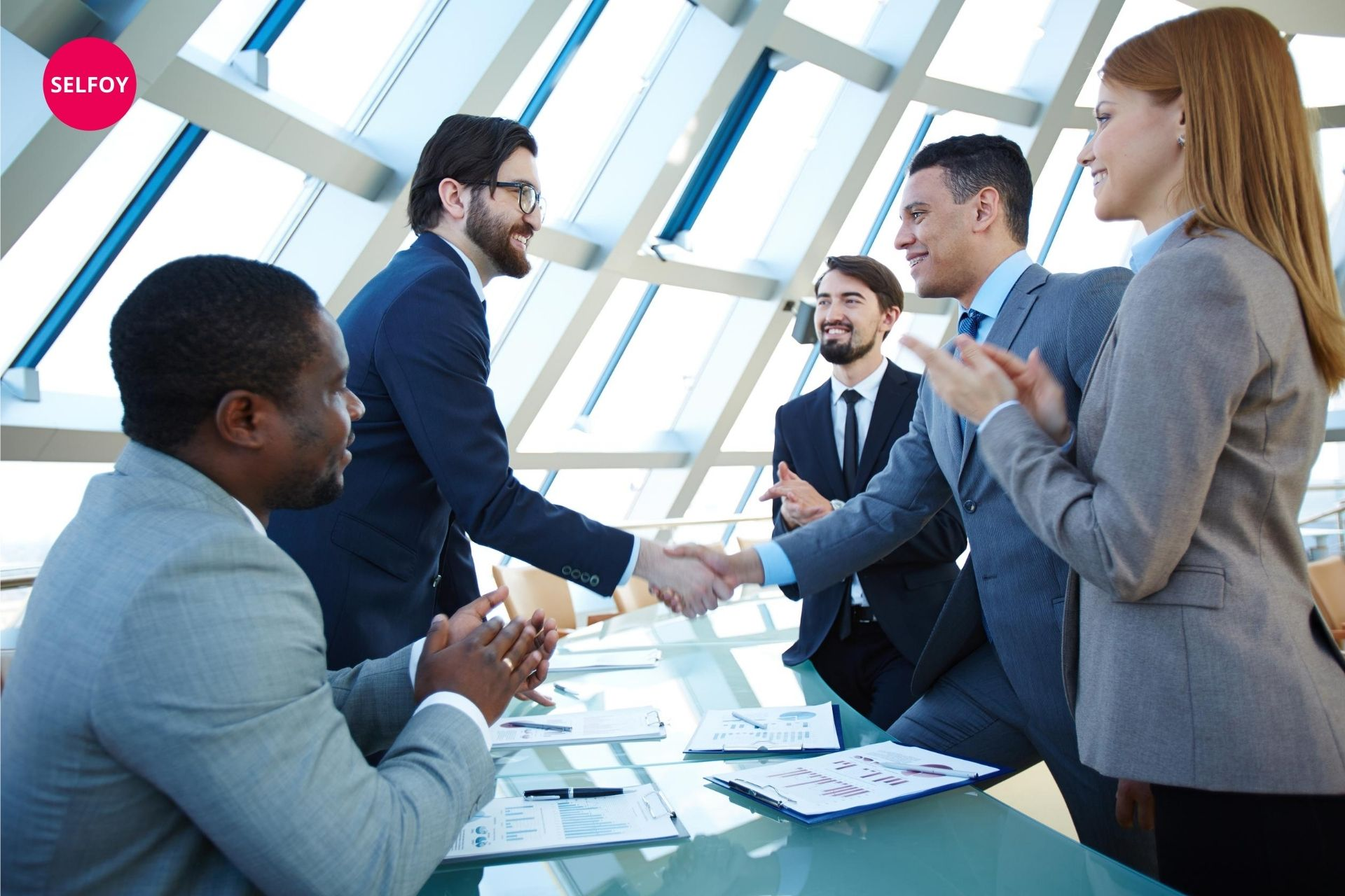 men are hand shaking of each other and showing characteristics of self confidence