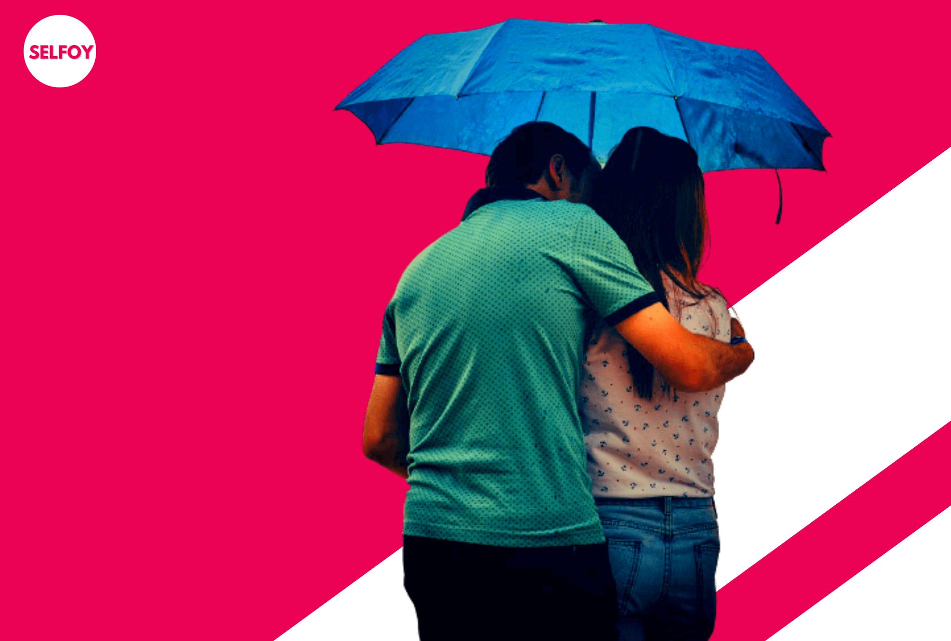 Why-does-being-in-love-feel-so-good-Man-cuddling-woman-under-umbrella